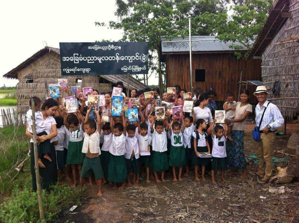 Students receiving necessities at school in West Yangon